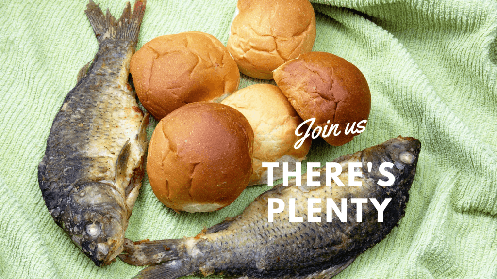 There's plenty - picture of two fish and 5 rolls on green picnic blanket. Join us.